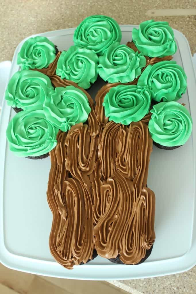 green frosting on chocolate cupcakes showing tree leaves