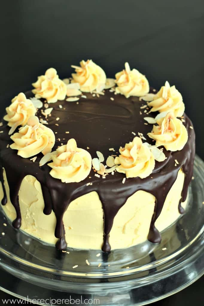 whole nanaimo bar layer cake with custard frosting chocolate ganache and frosting swirls