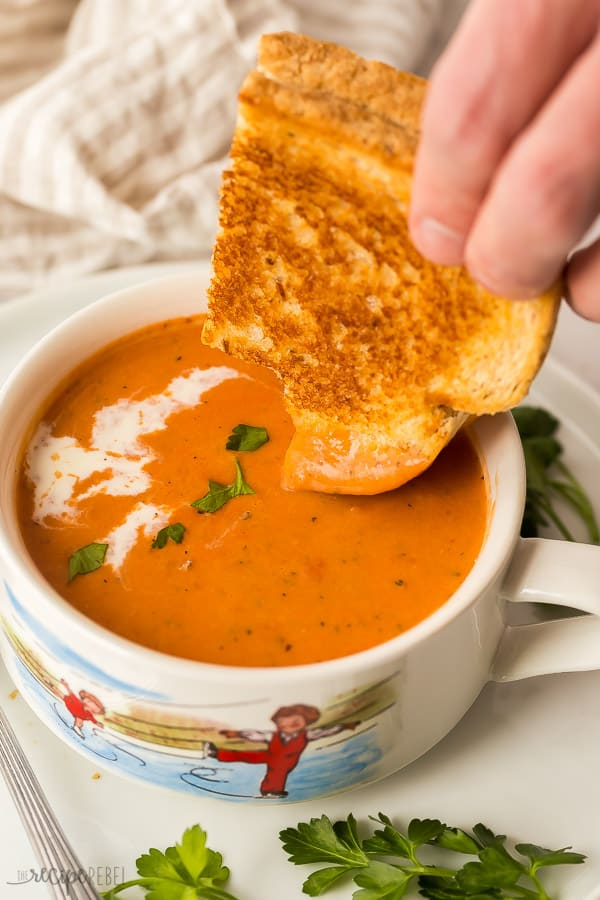 grilled cheese and creamy tomato soup dunking