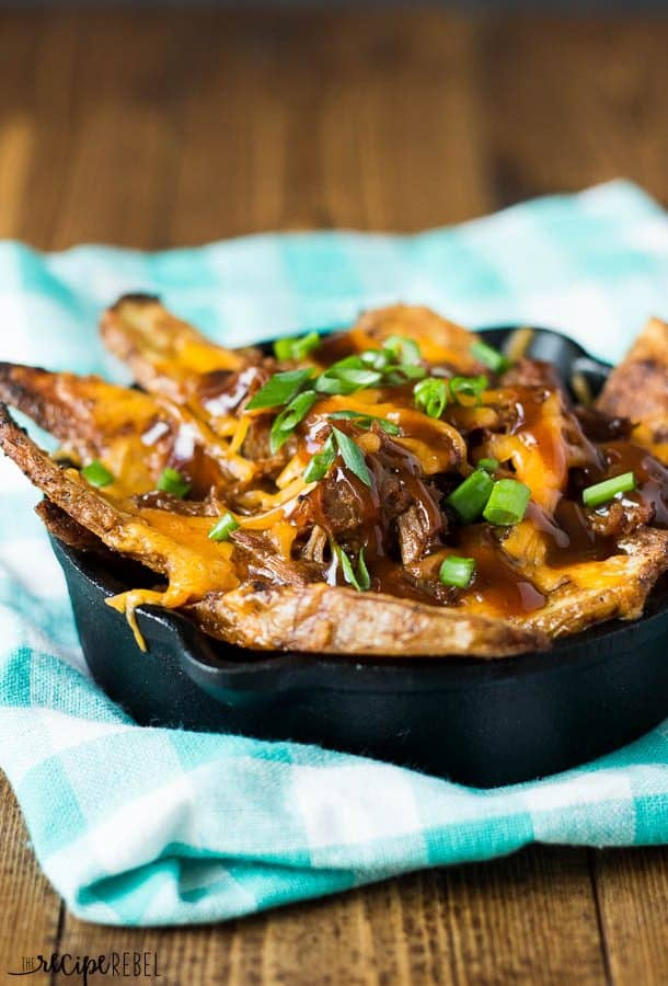 Crispy, oven baked fries topped with slow cooked shredded beef, barbecue sauce and cheddar cheese: the perfect way to use up leftover barbecue shredded beef!