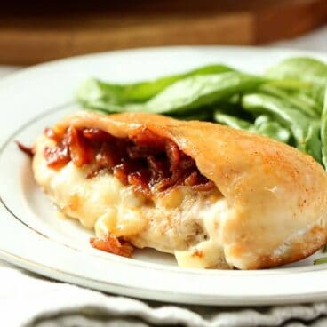 Bacon Jam Stuffed Chicken Breasts: Juicy chicken stuffed with mozzarella cheese and maple bacon jam - the best stuffed chicken you've ever had! www.thereciperebel.com