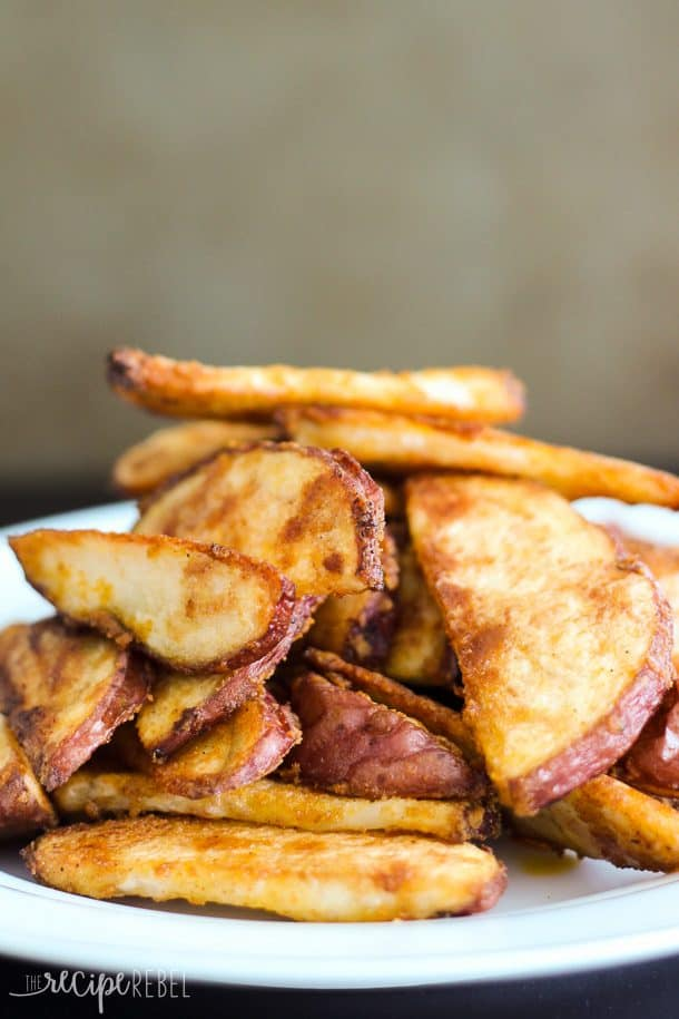 stack of crispy baked fries on white plate