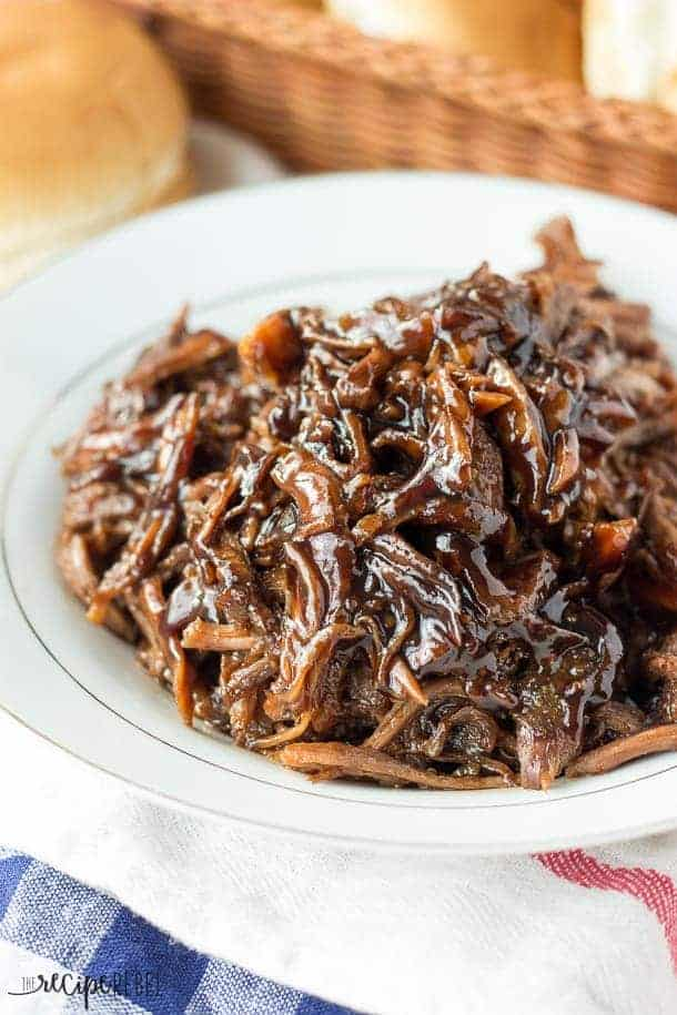 close up image of pulled pork with honey balsamic sauce in white plate