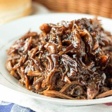 Slow Cooker Honey Balsamic Pulled Pork:Incredible thick, sweet and tangy honey balsamic sauce over slow-cooked pulled pork -- my absolute favorite way to do pulled pork! Perfect crockpot meal for summer or a busy weeknight! www.thereciperebel.com