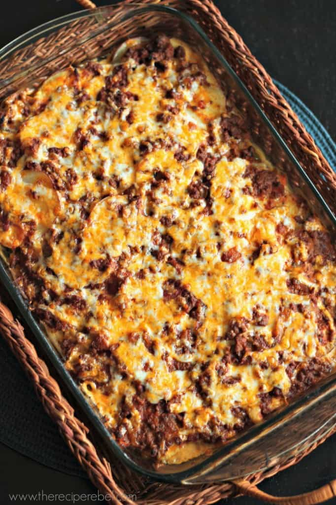 overhead image of mexican scalloped potatoes with ground beef and shredded cheddar cheese