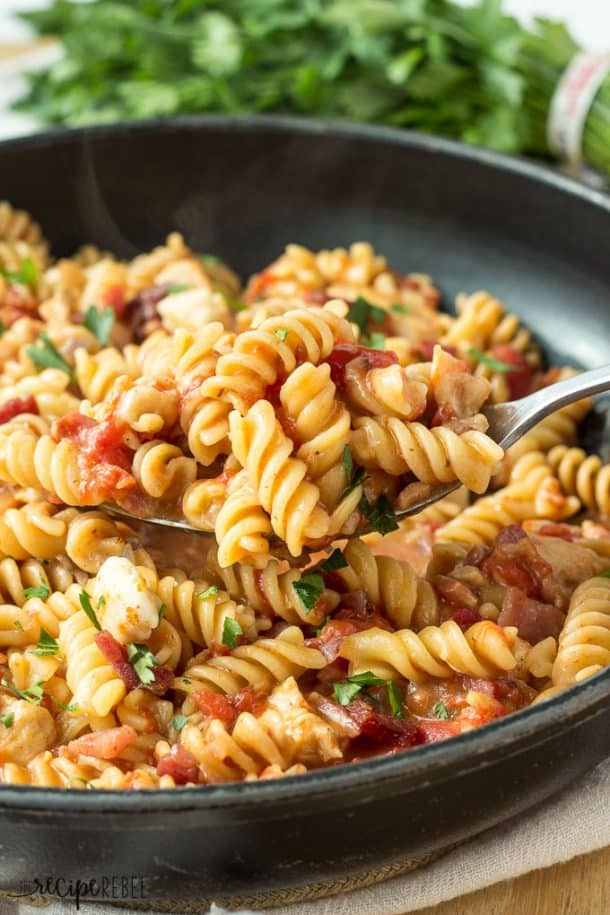 One-Pot BBQ Chicken and Bacon Pasta: smoky, cheesy pasta with chicken and bacon, that cooks completely in one pot! A quick, easy weeknight meal! www.thereciperebel.com