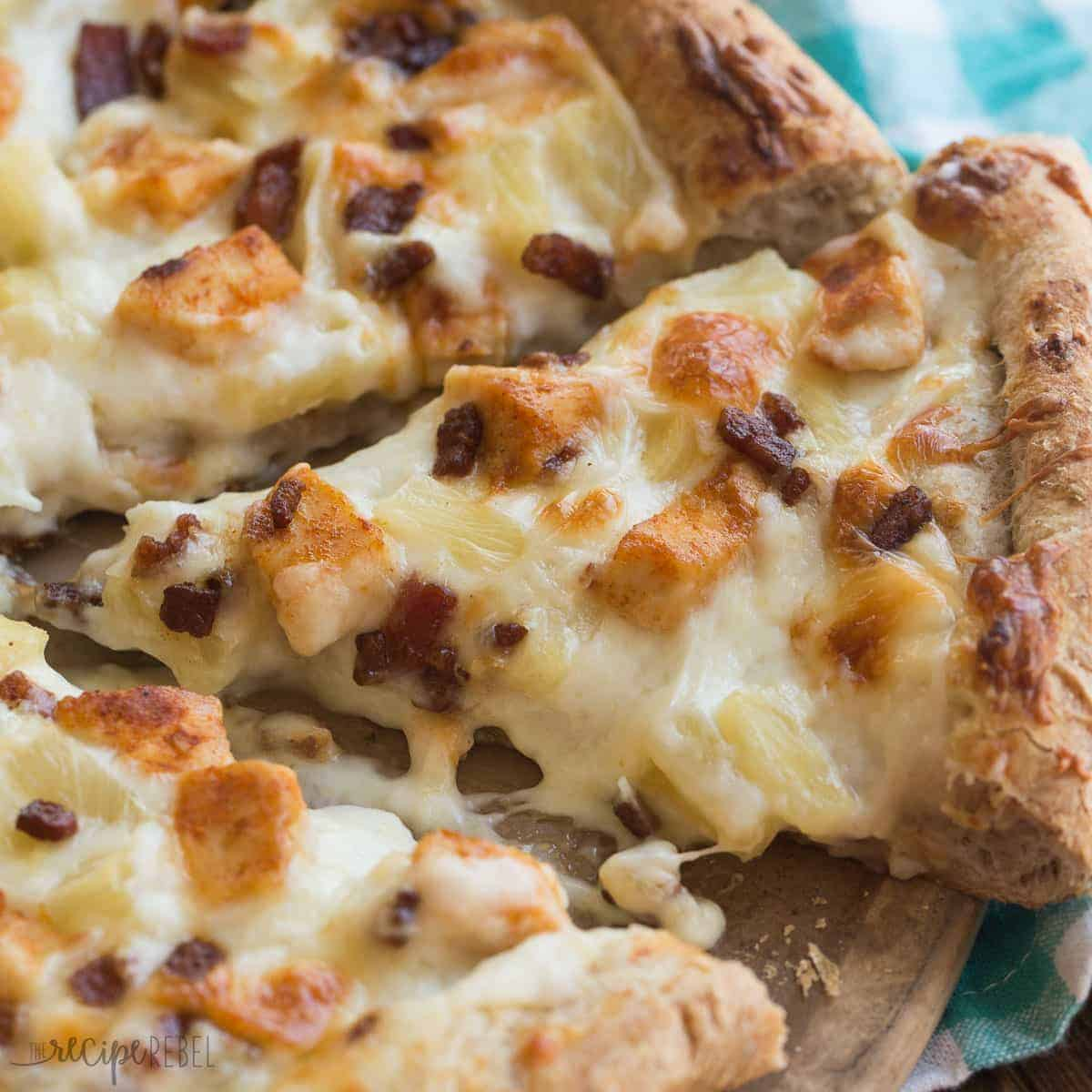 Boston Pizza copycat Tropical Chicken Pizza has alfredo sauce, spicy chicken, bacon and pineapple! A crazy but insanely good combination!