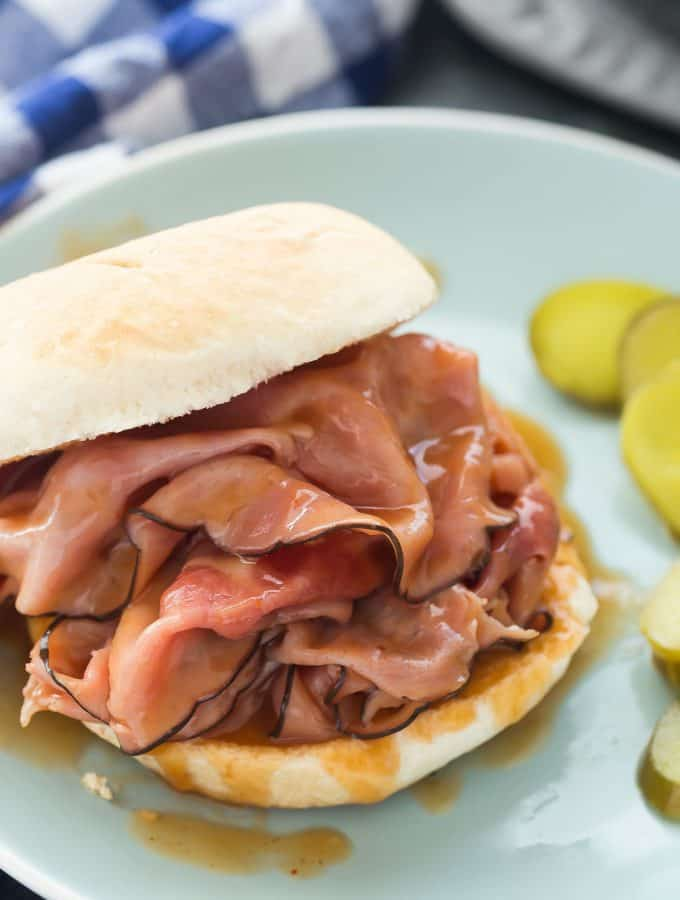 Sweet, smoky ham in an easy homemade barbecue sauce that you can whip up in 10 minutes! Beat the dinner time rush with this quick, flavorful meal! Includes step by step recipe video. | easy recipe | easy dinner recipe | slow cooker | crockpot | barbecue