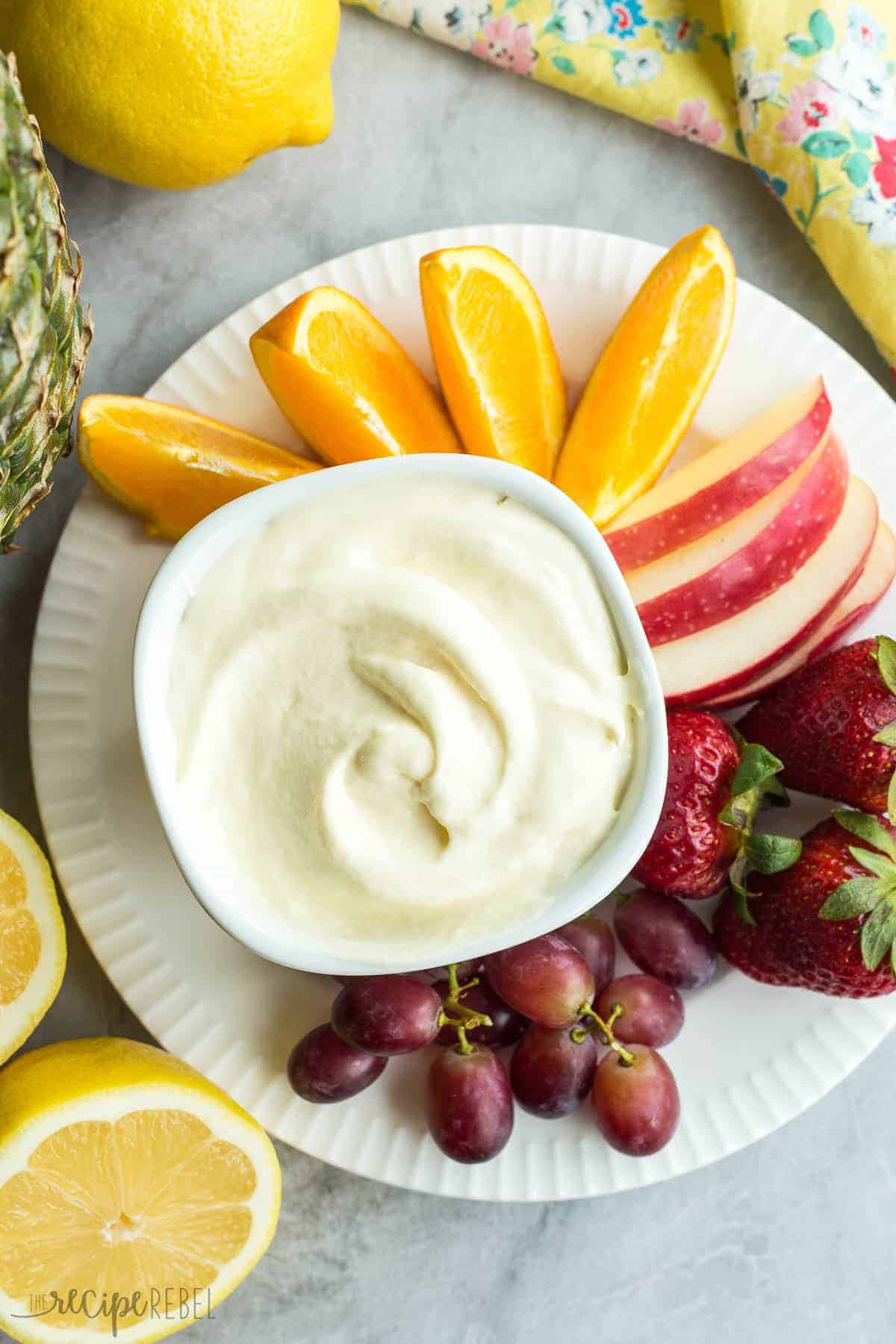 This creamy Pineapple Lemonade fruit dip is made with a homemade pineapple lemon curd and whipped cream! Change up the fruit juice flavors to make any kind!
