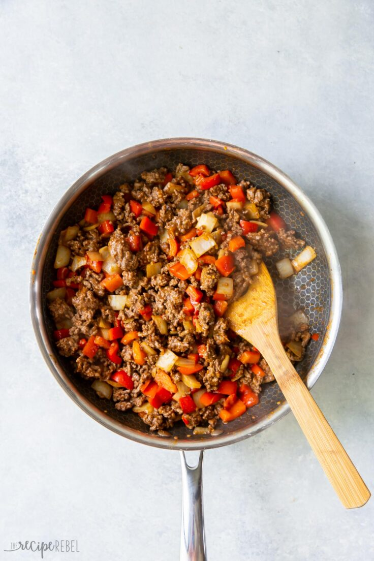 mexican shepherds pie filling being cooked in pan