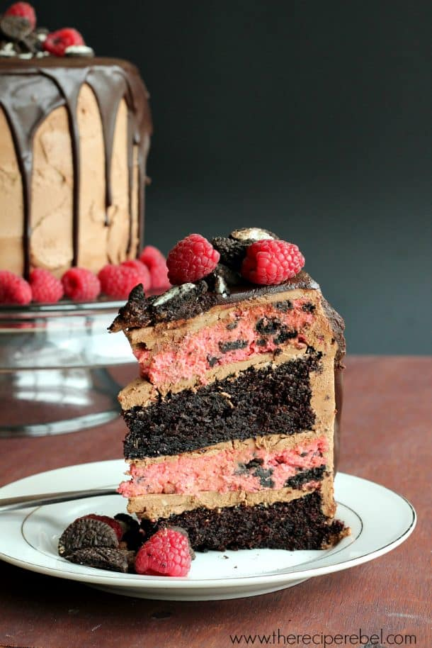 Raspberry Mocha Oreo Cheesecake Cake -- rich, fudgy mocha cake and creamy raspberry oreo cheesecake frosted with mocha frosting and covered in mocha ganache. Total decadence!