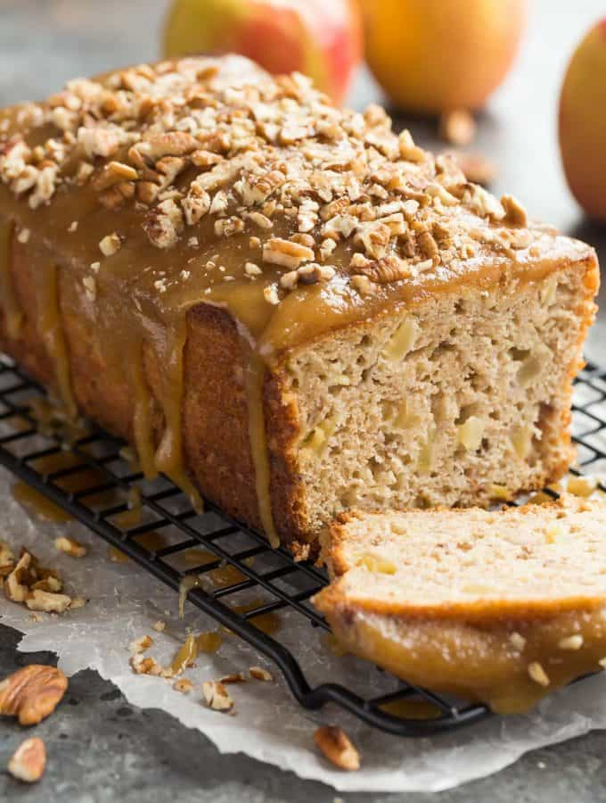 This Praline Glazed Apple Bread is so moist and decadent! It's loaded with apples and covered in an easy caramel glaze and chopped pecans -- perfect for fall or Thanksgiving baking! Includes step by step recipe video. | fall baking | thanksgiving brunch | breakfast | caramel | pecan | easy | apple picking | christmas | holiday