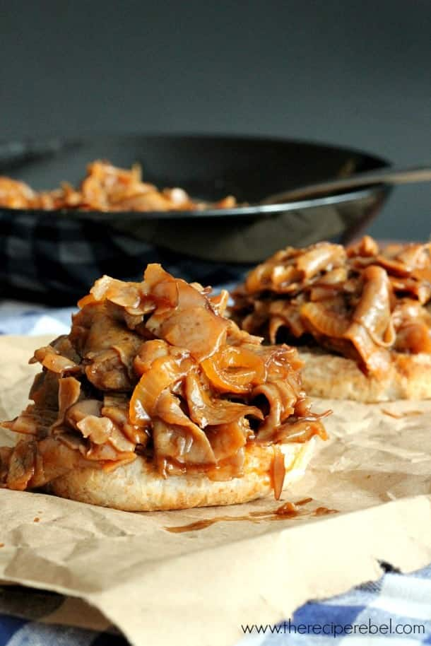 barbecue beef on bottom buns on parchment paper