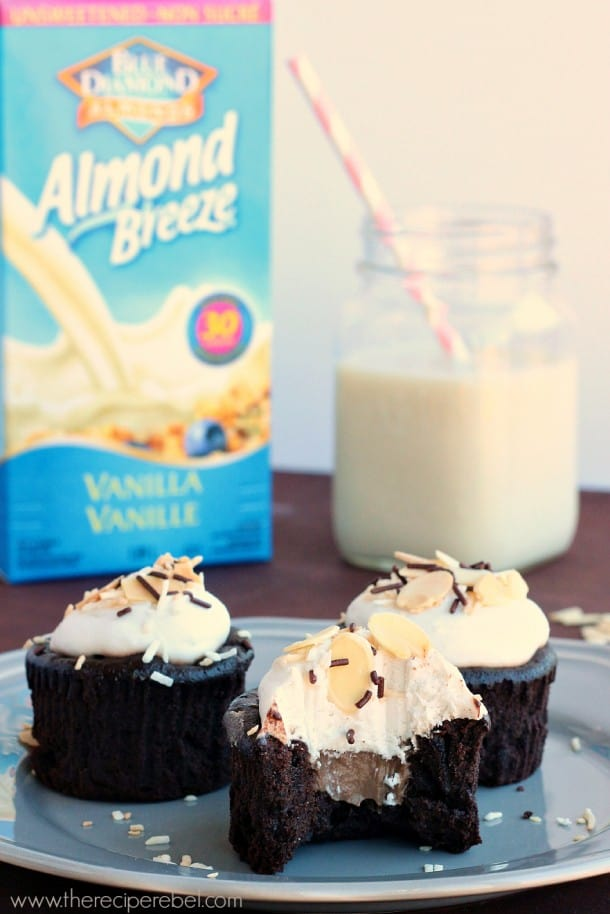 {Gluten-Free, Dairy-Free} Almond Joy Cupcakes: super rich, dense and fudgy cupcakes filled with chocolate almond pastry cream and topped with whipped coconut cream. You'll never believe they have no dairy or flour! www.thereciperebel.com