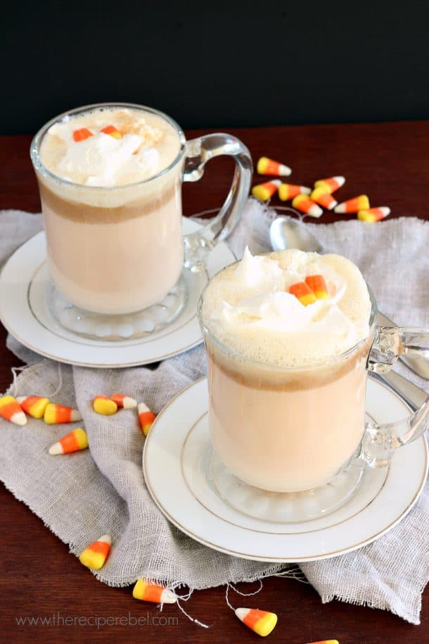 Candy Corn Peanut Butter White Hot Chocolate -- a totally decadent sweet treat to warm you up this Halloween! www.thereciperebel.com