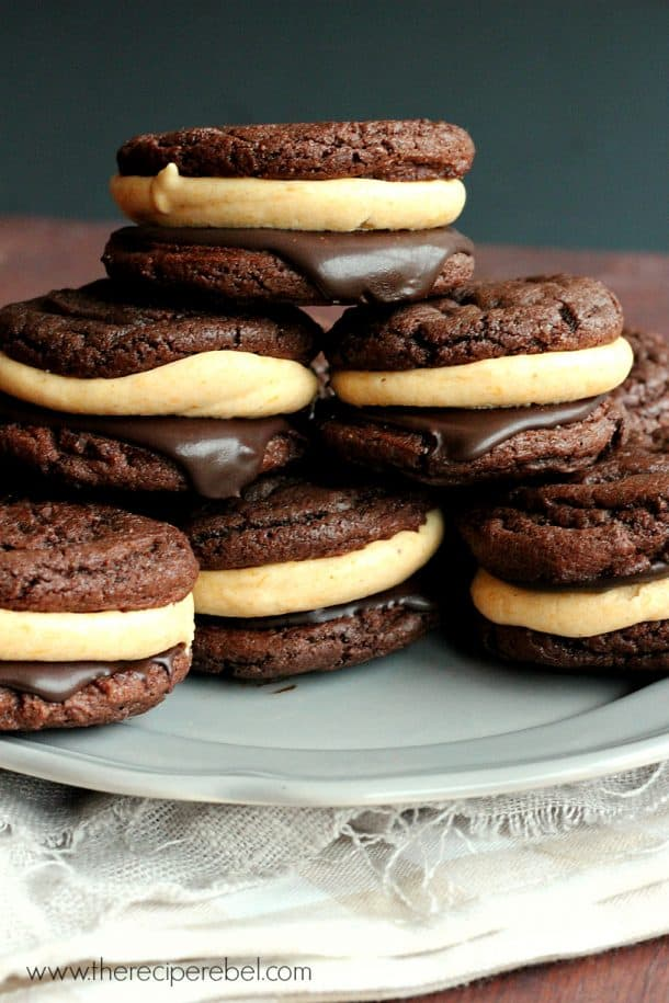 Double Chocolate Pumpkin Cheesecake Oreos -- super easy cake mix chocolate cookies filled with chocolate ganache and pumpkin cream cheese frosting.