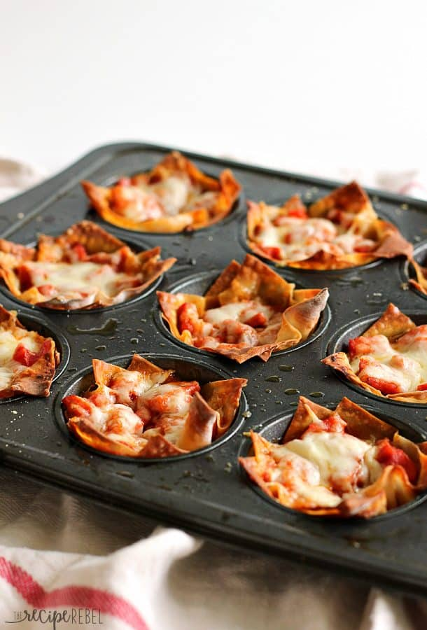 Pepperoni, cheese, and pizza sauce baked inside of crisp wonton wrappers: the ultimate handheld pizza! Only 4 main ingredients and 20 minutes! Perfect as an appetizer or a quick lunch.