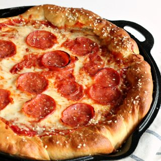 Deep-Dish Pretzel Crust Pizza -- the combination of the chewy, salty pretzel dough, sweet tomato sauce, spicy pepperoni and melty cheese is out of this world! You need to try this! www.thereciperebel.com