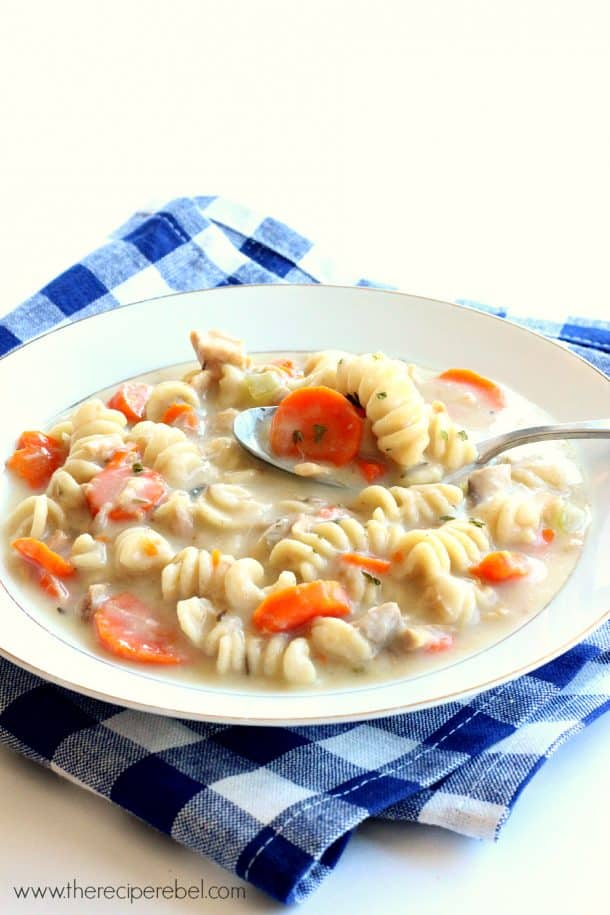 The easiest Slow Cooker Creamy Chicken Noodle Soup -- gets thick and creamy, unlike those recipes that just add milk or cream. Perfect for a chilly day!