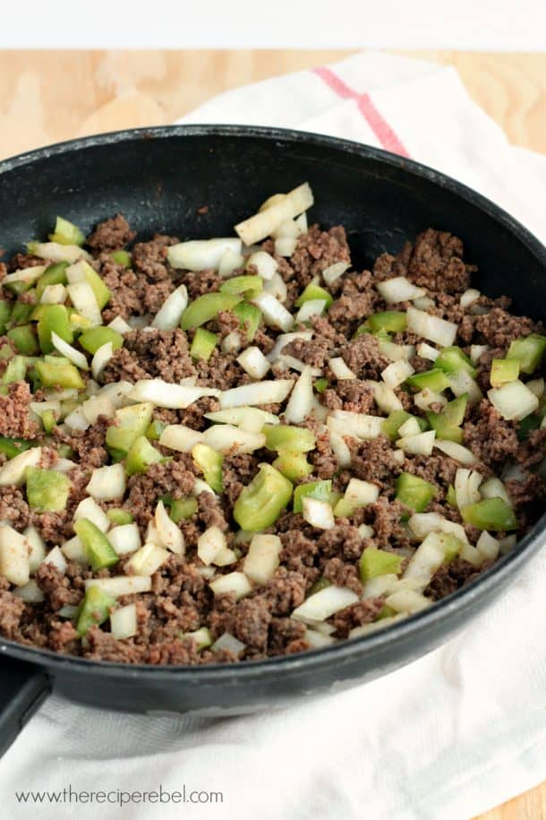 ground beef peppers and onions cooked in black skillet