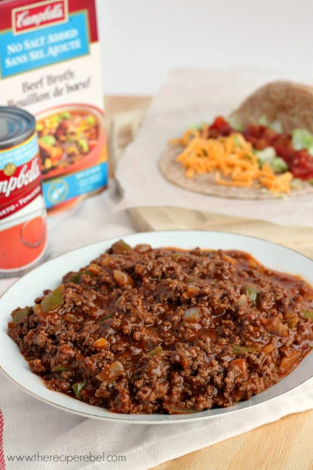 saucy taco meat on white plate in front of campbells tomato soup and beef broth