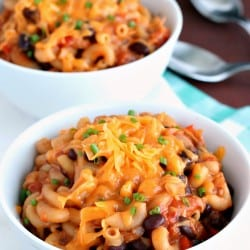{Slow Cooker} BBQ Chicken Chili Mac: a hearty one-pot pasta meal that cooks completely in the crockpot! Forget dirtying other dishes -- you can cook it all toegether without risking mushy pasta. www.thereciperebel.com