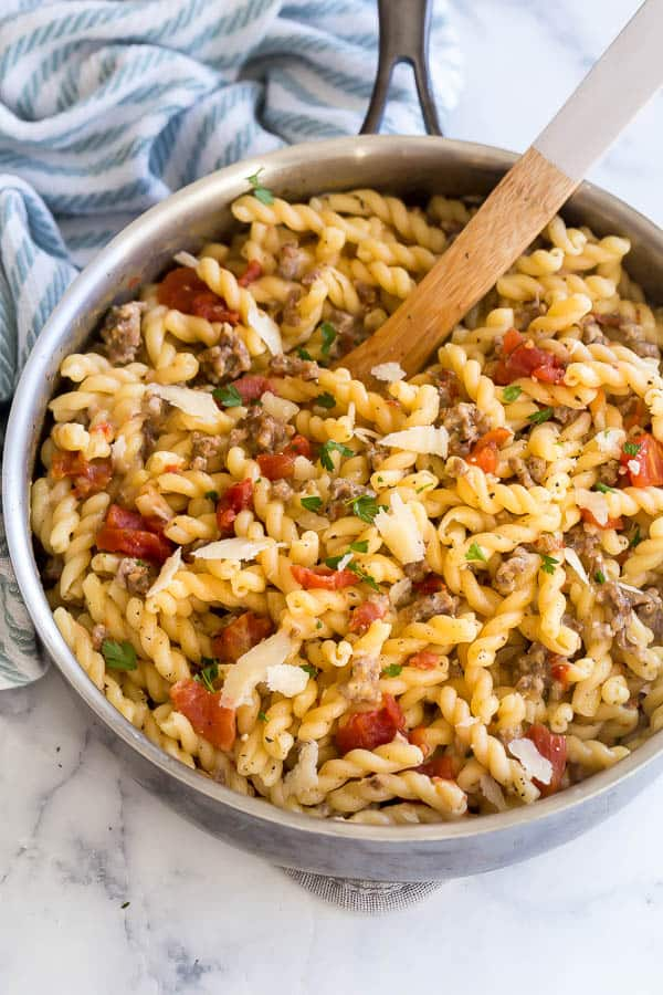 close up image of sausage tomato pasta in pan