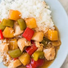 slow cooker sweet and sour chicken on blue plate