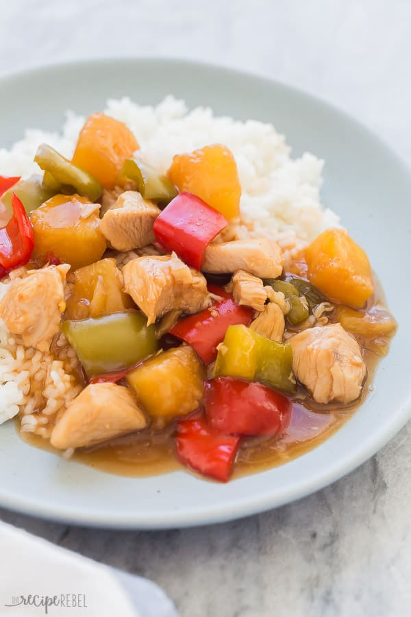 crockpot sweet and sour chicken on plate close up on grey marble