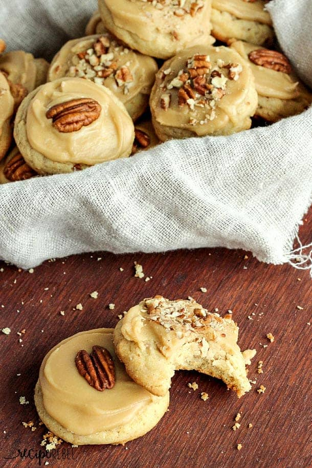 Brown Sugar Pecan Cookies: Soft, buttery pecan cookies topped with brown sugar frosting and more pecans -- one perfect cookie! Great for Christmas baking or any day of the year! www.thereciperebel.com