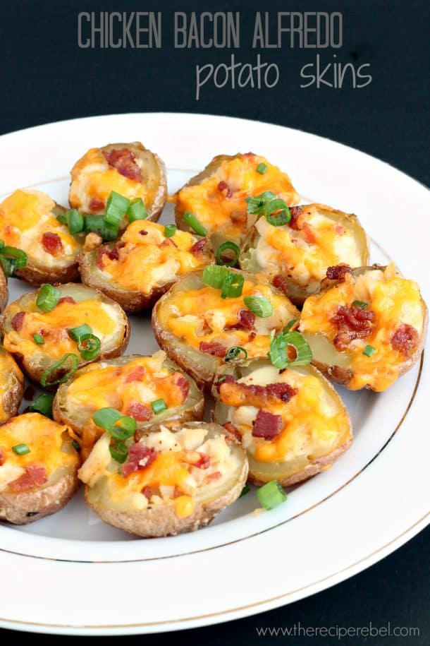 chicken bacon alfredo potato skins on white plate topped with green onions