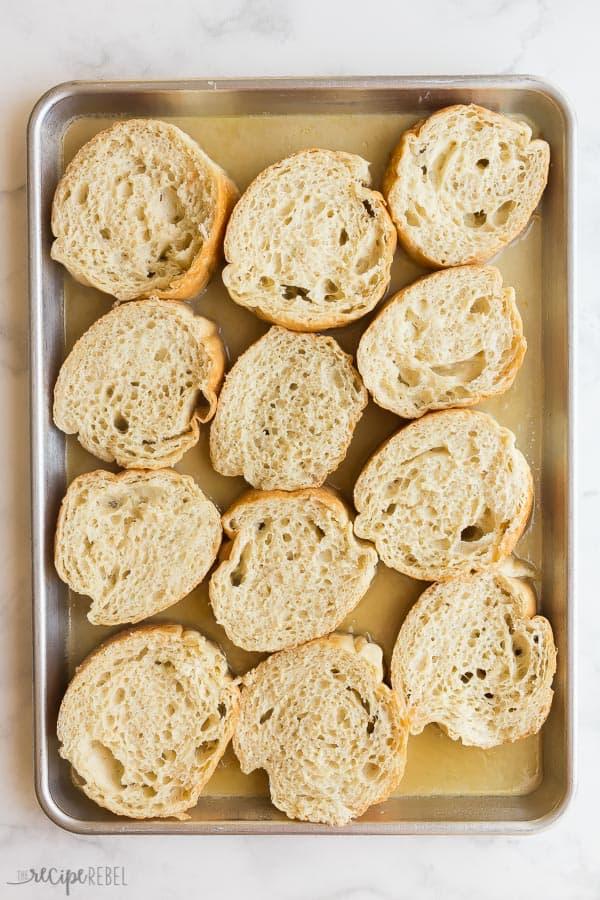 overnight french toast sheet pan before baking on white marble background