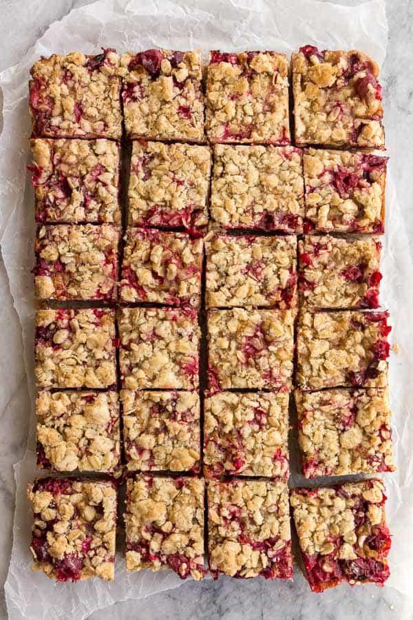 cranberry caramel bars overhead cut into squares