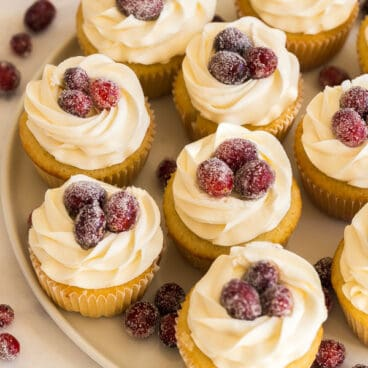 white chocolate cranberry cupcakes with sugared cranberries