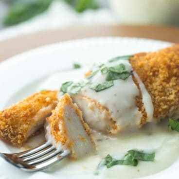Light Chicken with Basil Cream Sauce is a healthy, easy weeknight meal that's full on flavor and light on calories!