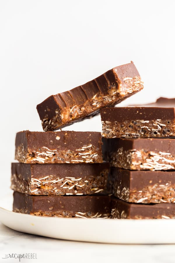 tall stack of chocolate crunch bars with one bite missing