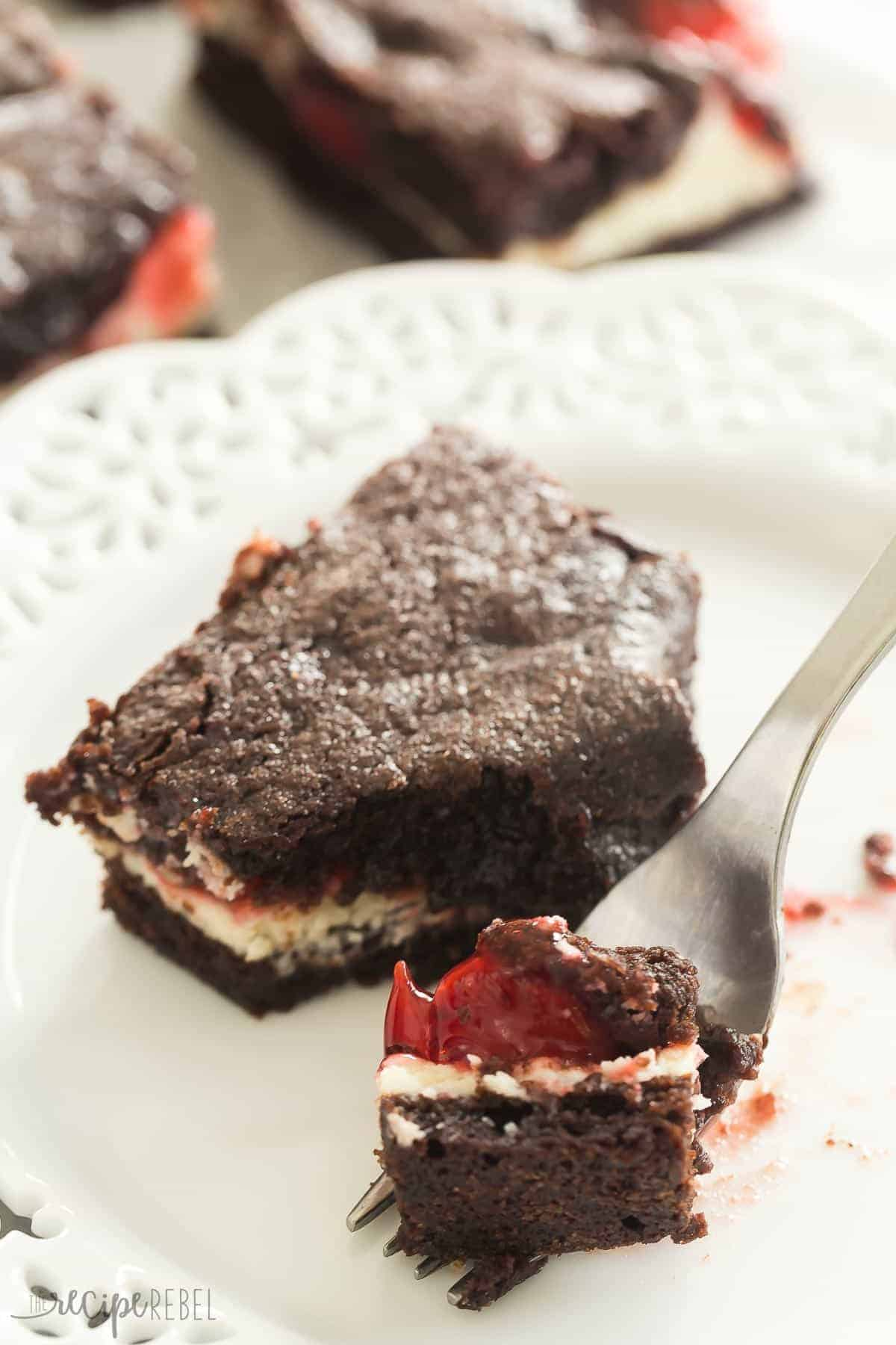 These Cherry Cheesecake Brownies start with fudgy homemade brownies, and are filled with cheesecake and cherry pie filling. They are the BEST brownies! | brownie recipe | dessert recipe | cheesecake recipe | cream cheese | pie filling