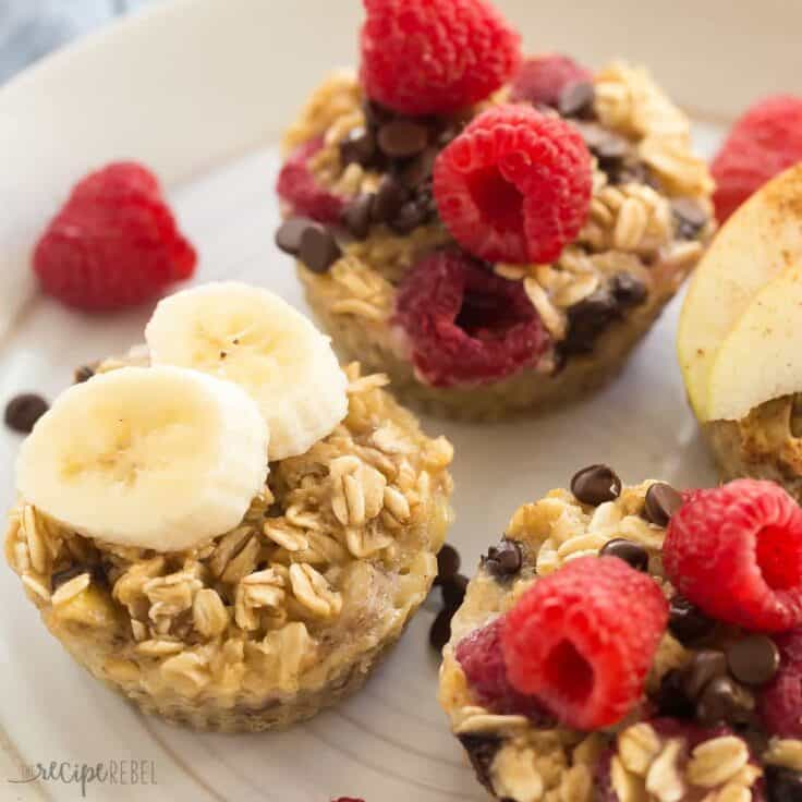 four ingredient baked oatmeal cups on white plate with banana slices and raspberries