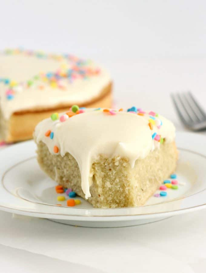 Gluten-Free Coconut Cake with Cream Cheese Frosting: a super easy, naturally flourless cake that's moist and full of coconut flavor! Perfect for Easter or Spring! www.thereciperebel.com