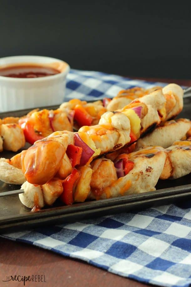 BBQ Chicken Pizza Kebabs: A grilled BBQ Chicken Pizza on a stick! Red pepper, pineapple, red onion, chicken and pizza dough all covered in pineapple brown sugar barbecue sauce, skewered and barbecued to smoky, grilled pizza perfection. www.thereciperebel.com