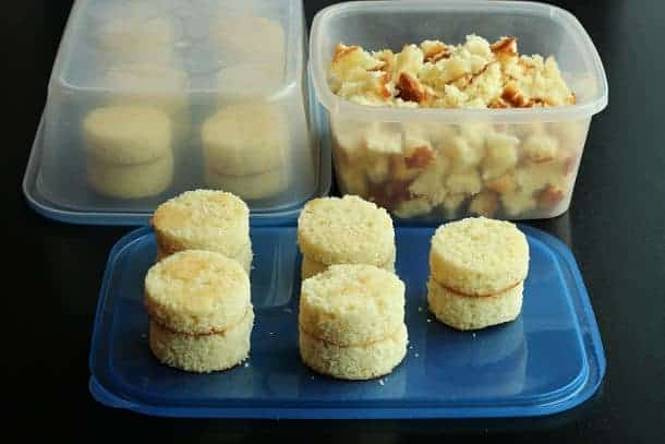 image of vanilla cake cut into rounds and pieces left over in container