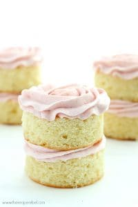 Mini Vanilla Layer Cakes with Strawberry Swiss Meringue Buttercream: the perfect moist vanilla cake and fluffy not-too-sweet strawberry frosting! Great for any birthday or Spring celebration. www.thereciperebel.com