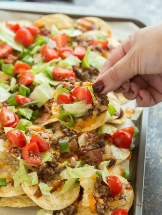 ground beef nachos on a sheet pan