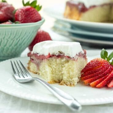 Gluten-Free Strawberry Upside Down Cake: Super moist, coconut-based cake baked with a layer of juicy strawberries underneath! Flip it and top with whipped cream and more berries for a special summer treat that's perfect for Canada Day or the Fourth of July! www.thereciperebel.com