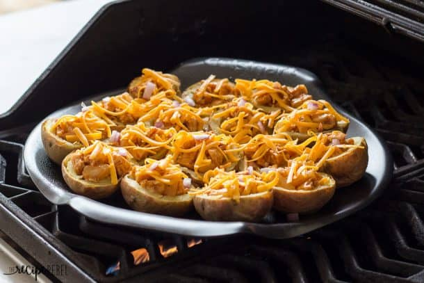 Grilled BBQ Chicken Potato Skins: BBQ chicken, pineapple, red onion, barbecue sauce and cheese, all loaded up in a tender potato shell, and grilled on the barbecue! The perfect summer appetizer or picnic lunch. www.thereciperebel.com