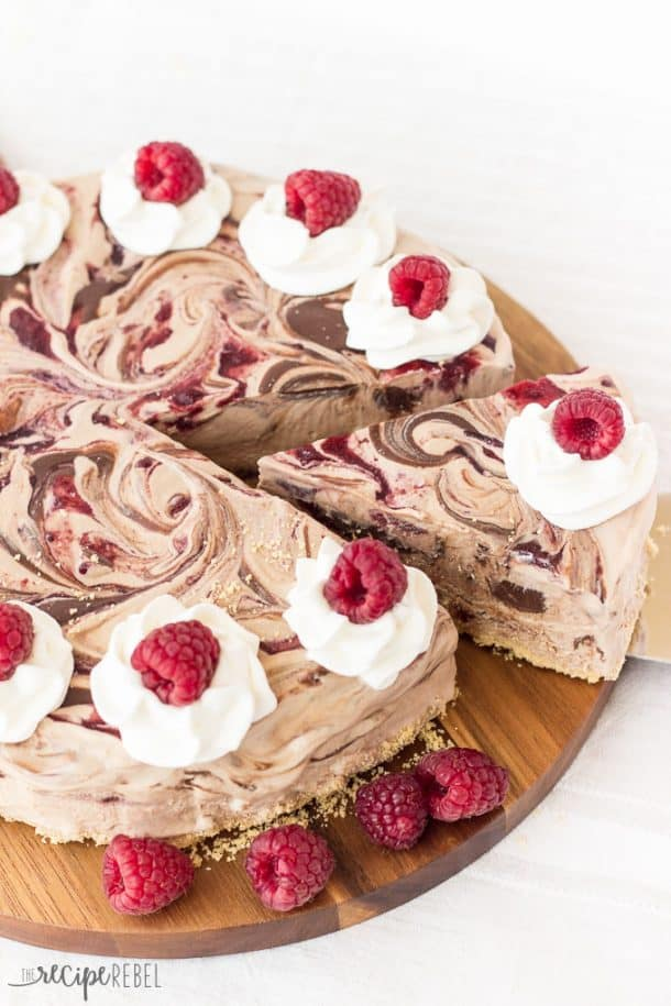 An easy ice cream cake made 3-ingredient no-churn chocolate ice cream swirled with Nutella and raspberry preserves. All on a crust made with crushed ice cream cones! The perfect simple, no-bake summer dessert!