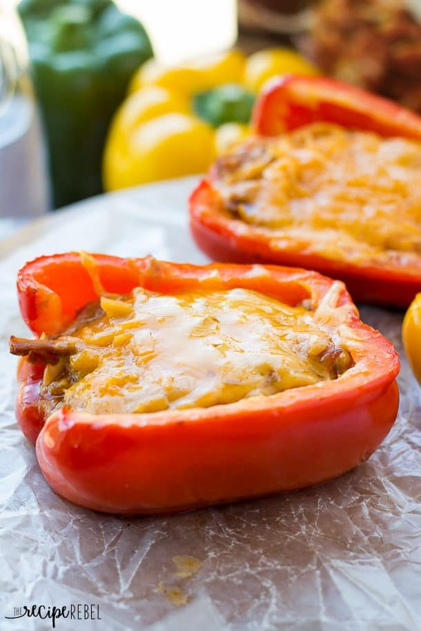 close up of stuffed pepper with pulled pork and melted cheddar cheese