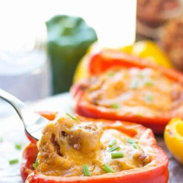 Grilled Pulled Pork Stuffed Peppers and a GIVEAWAY! Sweet bell peppers stuffed with sweet, smoky, tender pulled pork and cheddar cheese and grilled to perfection! Wrap them in tin foil and they're great for making ahead or packing in a picnic. Only 3 ingredients! Can be made on the grill, in the oven or in the slow cooker. www.thereciperebel.com
