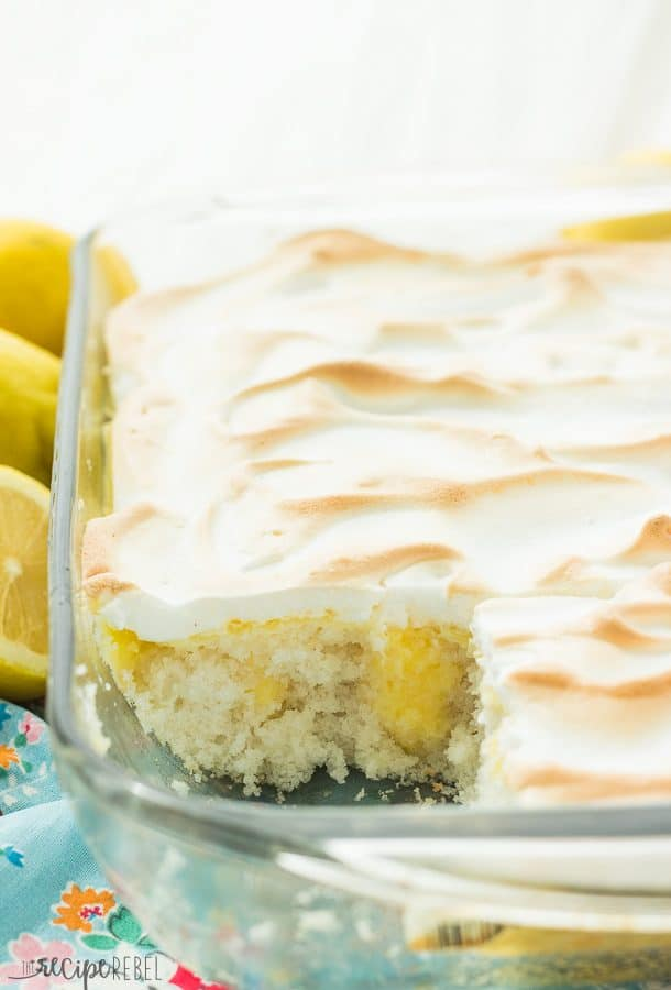 Skinny Lemon Meringue Poke Cake: Starts with a cake mix or scratch vanilla cake, this poke cake is covered in homemade lemon curd (or use store bought for a shortcut) and easy meringue -- a great light dessert for Spring or Summer! www.thereciperebel.com