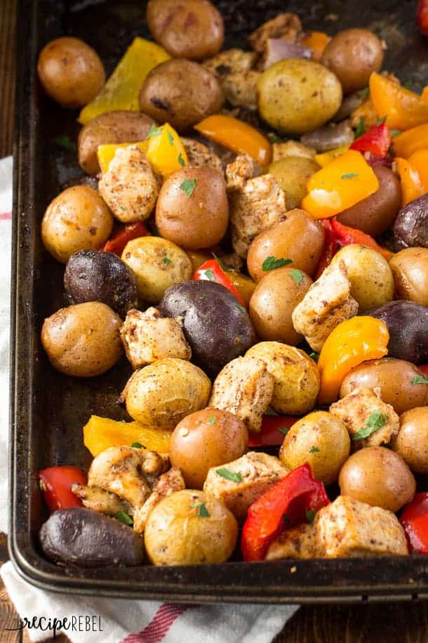chicken fajita sheet pan dinner with peppers and potatoes close up on sheet pan
